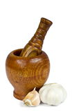 Mortar and pestle. Mortar,pestle and garlics on white Royalty Free Stock Photos