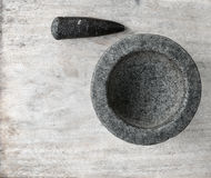 Mortar and pestle antique kitchenware. Mortar and pestle on a wooden table Stock Images
