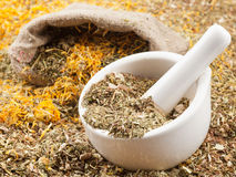 Mortar, pestle and bag of healing herbs Royalty Free Stock Image