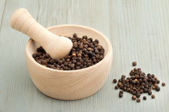 Mortar and pestle with black pepper Stock Image