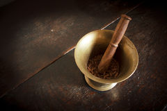 Mortar & Pestle with Cloves Stock Photo