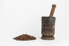 Mortar and pestle with coffee seeds Stock Images