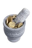 Mortar and Pestle with Coins Royalty Free Stock Photography