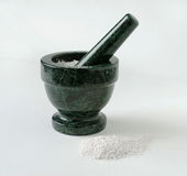 Mortar & Pestle with Crushed Substance Royalty Free Stock Images