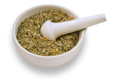 Mortar and pestle with dry herbs Stock Photos