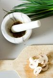 Mortar and pestle with food Royalty Free Stock Photos