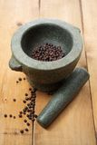 Mortar and pestle with fresh black pepper Stock Photos
