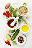 Mortar and pestle with fresh ingredients Stock Photo