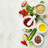 Mortar and pestle with fresh ingredients Royalty Free Stock Photo