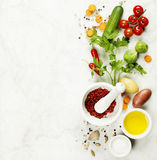 Mortar and pestle with fresh ingredients Royalty Free Stock Image