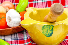 Mortar, pestle, fruits and vegetables Stock Images