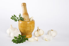 Mortar and pestle with garlic and parsley Royalty Free Stock Image