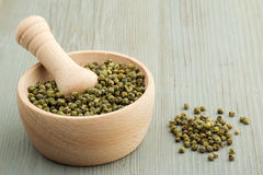 Mortar and pestle with green pepper Royalty Free Stock Images