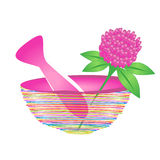 Mortar and pestle with herbal leaf and pink flower Royalty Free Stock Photos