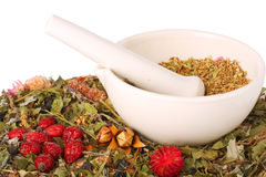 Mortar and pestle with herbs Royalty Free Stock Images