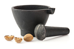 Mortar with pestle and nutmeg Stock Photo