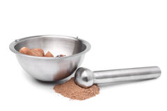 Mortar and pestle with nutmeg Royalty Free Stock Photos