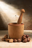 Mortar and Pestle with Nuts and Almonds. On Wood Stock Images