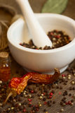 Mortar & pestle with pepper and chili Royalty Free Stock Photo