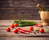 Mortar and pestle with pepper and spices Stock Photography