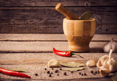 Mortar and pestle with pepper  on wooden table Stock Photography