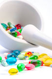 Mortar and pestle with pills Stock Image