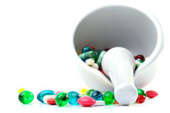 Mortar and pestle with pills Stock Photo
