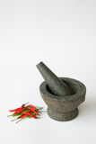 Mortar, Pestle and red chili Royalty Free Stock Images