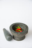 Mortar, Pestle and red chili Royalty Free Stock Photos