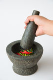 Mortar, Pestle and red chili Royalty Free Stock Photography