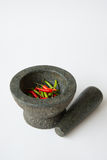 Mortar, Pestle and red chili Stock Photos