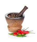 Mortar and pestle with red hot chili pepper and peppercorn Royalty Free Stock Photography
