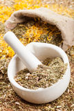 Mortar, pestle and sack of healing herbs Royalty Free Stock Photography