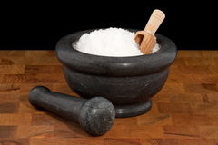Mortar and pestle with salt Royalty Free Stock Photo