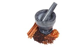 Mortar and pestle with spices. Gray mortar and pestle with spices Royalty Free Stock Photography