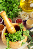 Mortar and pestle with spices Stock Photos