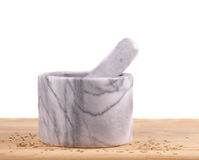 Mortar and pestle with сumin seeds Stock Photography
