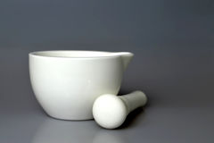 Mortar and pestle. White ceramic mortar and pestle Stock Photo