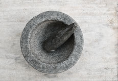 Mortar and pestle on a wooden table. Mortar and pestle antique kitchenware Stock Photos