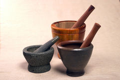 Mortar and Pestles. Group of three mortar and pestles - stone, ceramic and wooden Royalty Free Stock Photos