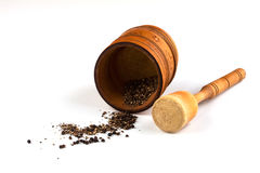 Mortar with pounded black pepper. And pestle on a white background Royalty Free Stock Photography