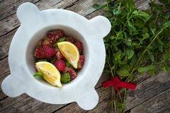 Mortar With Raspberries, Mint And Lemon Stock Image