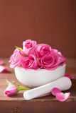 Mortar with rose flowers for aromatherapy spa Royalty Free Stock Images