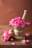 Mortar with rose flowers for aromatherapy and spa Stock Images