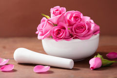 Mortar with rose flowers for aromatherapy and spa Royalty Free Stock Images