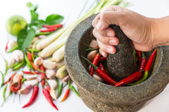Mortar with thai spices and herb. (garlic, chili pepper, lemon grass, kaffir lime leaf Royalty Free Stock Photos