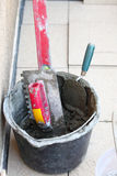 Mortar on wall construction notched trowel Stock Photos