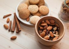 Mortar with walnuts and cinnamon Royalty Free Stock Image