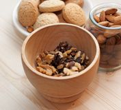 Mortar with walnuts, cookies and almonds Stock Photos