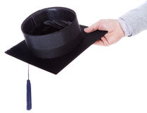 Mortarboard academic graduation. Cap in the hand Royalty Free Stock Image